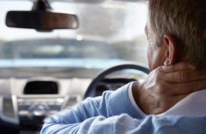 Driver Suffering From Whiplash From Car Accident