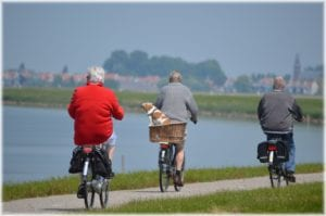 seniors active riding bikes without back pain from degenerative joint disease