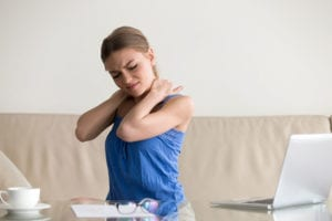 Woman holding neck in pain from fibromyalgia