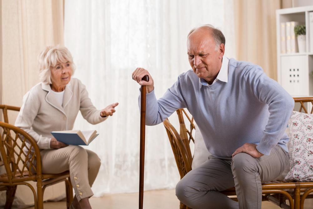 Elderly Man hurting due to arthritis pain.